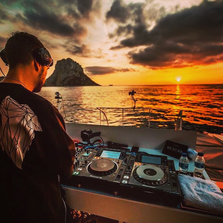Don Diablo on a boat in Ibiza at sunset